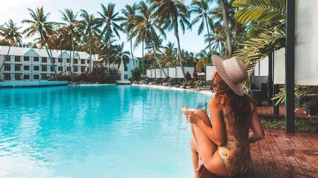 Relax poolside at the Sheraton Grand Mirage Resort, Port Douglas