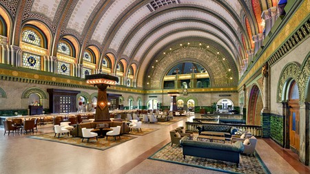 At the Union Station Hotel, the former railway station's original arched roofs stretch over the Grand Hall restaurant