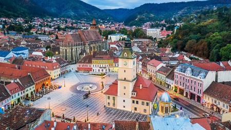Pretty as a picture; the romantic city square in Brasov, Romania is surrounded by fantastic hotels in which to enjoy an authentic Transylvanian experience – with sweeping forests, gothic churches, and Dracula's castle on the horizon
