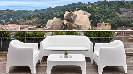 Overlook the most famous site in Bilbao, Frank Gehry's Guggenheim, from your hotel rooftop