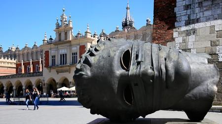 Igor Mitoraj's huge hollow statue of Eros's head rests in Krakow's Market Square