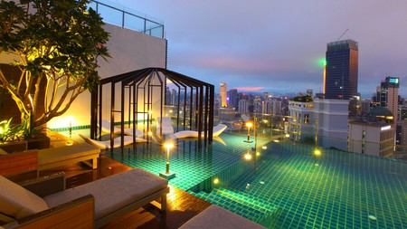 Enjoy city views from the sun-deck pool at the Tribeca Hotel in Kuala Lumpur
