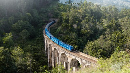 Travelling by train through the mountains in Ella, Sri Lanka, gives you the chance to take in forests, rivers and tea plantations