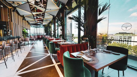 Bask in panoramic views across the city from a 12th-floor restaurant and bar