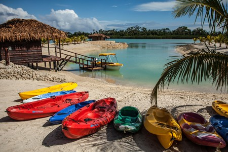 Swim or kayak in an inviting lagoon, surrounded by lush tropical rainforest