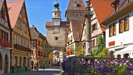 Rothenburg ob der Tauber is a walled medieval town filled with flower-filled window boxes, cobblestone alleyways and painted houses