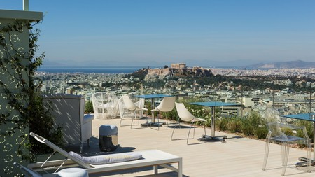 See far beyond Athens, all the way out to the Saronic Islands, from your hotel rooftop