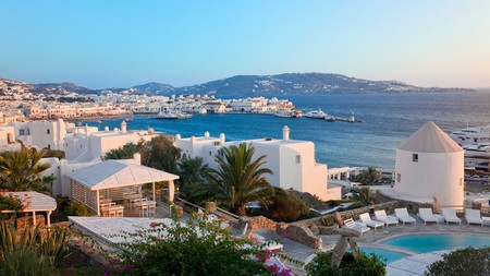 Catch a sunset over the harbour in Mykonos on a Greek getaway