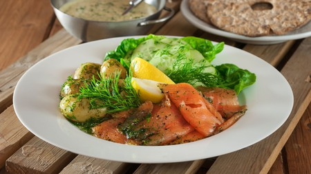 Gravlax is tasty dill-cured salmon that often comes with a side of dill potatoes
