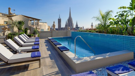 Recline above the cityscape at your very own rooftop pool
