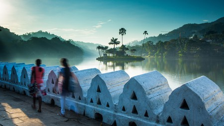 Rest near the tranquil waters of the protected Kandy Lake