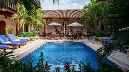 Relax by the pool at Hotel Plaza Colon in Granada, Nicaragua