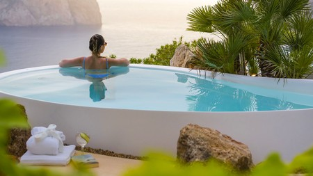 Set on a coastal cliff and surrounded by a pine forest, Ibiza's Hacienda Na Xamena was made for luxurious getaways.