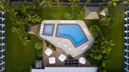 Eat dinner poolside, with sunset views over Suva Harbour