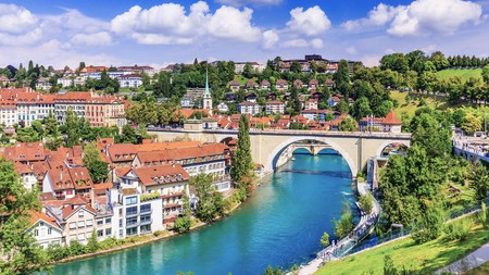 A view across the Unesco World Heritage Centre of Bern and its Old Town, toward the Nydeggbrucke bridge across the river Aare