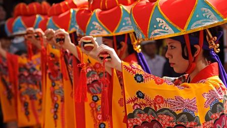 Performers wearing 'bingata' kimonos dance at a local festival celebrating Ryukyu culture, in Okinawa