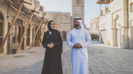 Emirati women wear a black gown known as an 'abaya', while men wear a robe called a 'dishdasha' or 'kandura'
