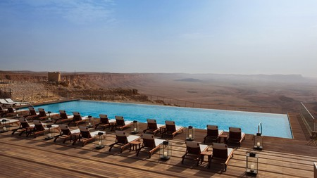 Soak up the views of the Ramon Crater and Negev Desert while taking a dip in the pool