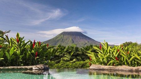 Enjoy a view of the Arenal Volcano while soaking in a thermal pool at the Springs Resort