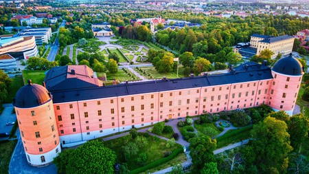Uppsala Castle dominates its surroundings with its unmissable peach-coloured facade
