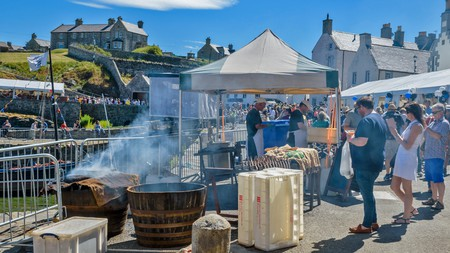 Foodies queue for their Arbroath smokies at the Portsoy Festival in Aberdeenshire