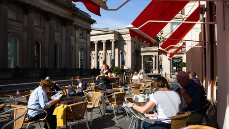 Hipsters get their caffeine fix in a rare moment of Scottish sunshine at Royal Exchange Square, Glasgow