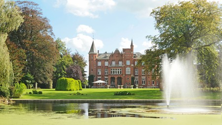 Hotel Lodewijk Van Male in Bruges, Belgium, sits against a beautiful green backdrop