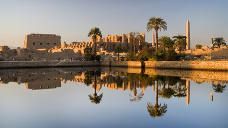The Temple of Karnak, in Luxor, reflected in the sacred lake at sunset