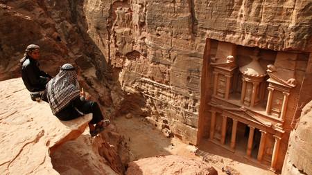C00MH8 Bedouins relax near the Treasury (El Khazneh) at Petra, Jordan.