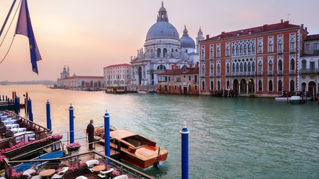 Book a luxury hotel room on this city's famous waterfront, to experience Venetian opulence in full.