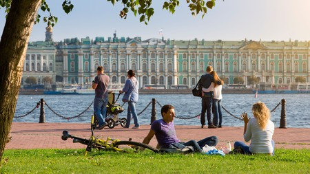 Stroll the banks of the Neva River to catch a memorable sunset in St. Petersburg