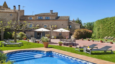 One of the gems of Girona, El Racó de Madremanya Hotel combines rustic Catalan charm with boutique luxury