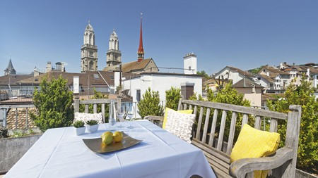 The rooftop terrace at Hotel Rössli offers lovely views of the surrounding rooftops and Grossmünster in Zürich