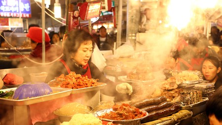 Food stalls like Gwangjang Market are not to be missed during a stay in Seoul