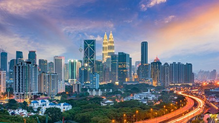 A panoramic view of Kuala Lumpur, Malaysia, including the iconic Petronas Twin Towers