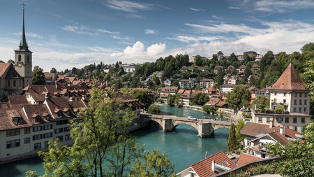 The view across the Aare River, the Untertorbrucke bridge and the Old Town of Bern, Switzerland