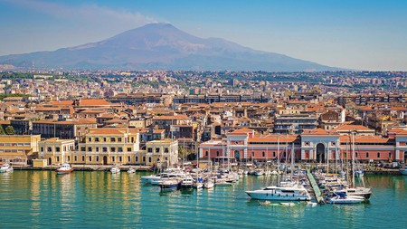 On the horizon, Mount Etna provides a beautiful backdrop to the cityscape of Catania, Italy