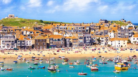Take a dip in St Ives bay, Cornwall, with its pretty fishing boats © Chris Harris / Alamy