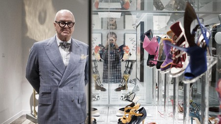 Manolo Blahnik stands next to some of his creations at 'The Art of Shoe' exhibition at the National Museum of Decorative Arts in Madrid