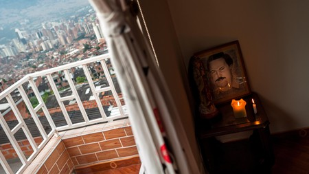 An altar in honor of drug lord Pablo Escobar in a living room in Medellin