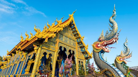 The striking blue Wat Rong Suea Ten temple is one of the gems you will find during a stay in Chiang Rai