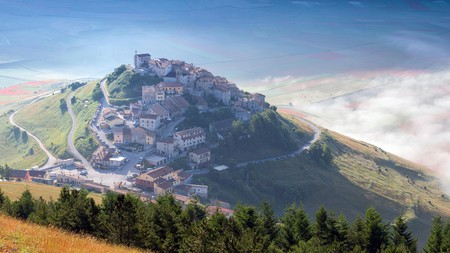Sunrise over Castelluccio di Norcia, the Umbrian town famed for its food, history and picture-postcard looks