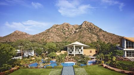 Mountains provide a scenic backdrop for the Taj Aravali Resort & Spa in Udaipur, India
