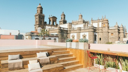 The rooftop pool at Veintiuno Emblematic Hotel offers stunning views over Las Palmas