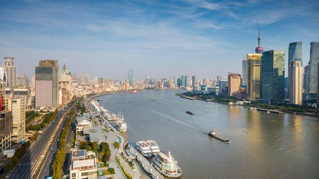 Take in modern skyscrapers and old European-style buildings while walking along the Bund in Shanghai