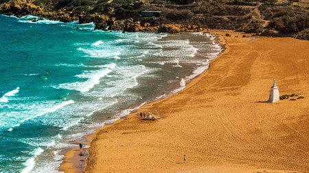 Feel the soft golden-red sands of Ramla Bay in Gozo run through your toes