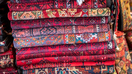 Traditional Iranian carpets are made with natural dyes, so look for colours that seem to come from nature