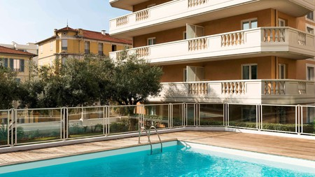 Enjoy lazy days by the sun-drenched pool at the Aparthotel Adagio