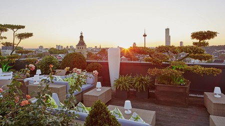 Enjoy a drink at sunset on the rooftop terrace at the Savoy