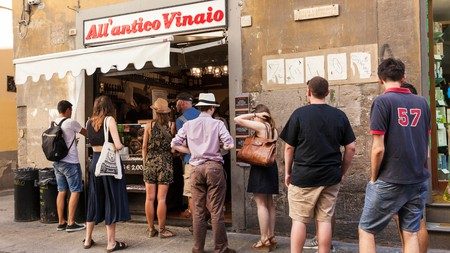 Locals in Florence queue at All'Antico Vinaio, one of the places you should visit on a foodie trek through Italy